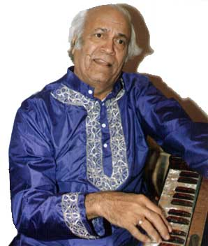 Picture of S. D. Batish playing the harmonium. Copyright �2003 Batish Institute.