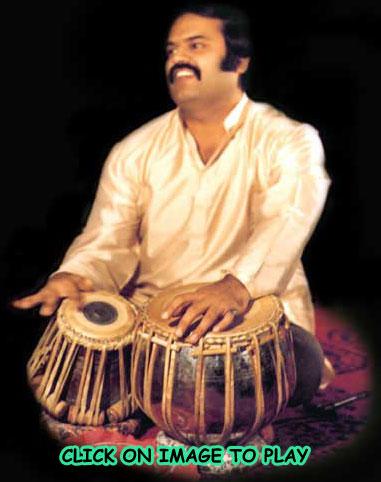 Click on image to hear Ashwin Batish playing the tabla!